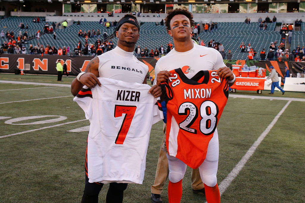 . Cincinnati Bengals running back Joe Mixon, left, and Cleveland Browns quarterback DeShone Kizer, right, exchange jerseys after an NFL football game, Sunday, Nov. 26, 2017, in Cincinnati. (AP Photo/Gary Landers)