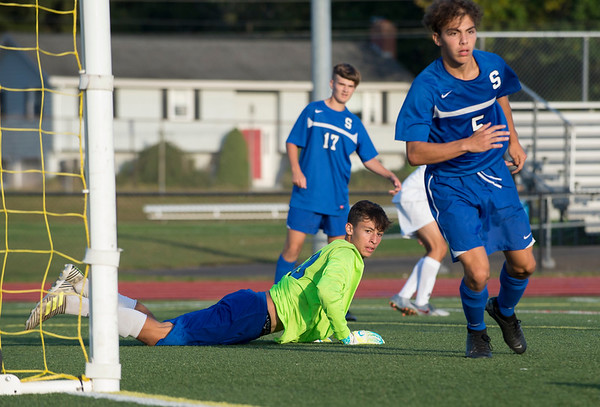 10/01/19 Wesley Bunnell   StaffrrSouthington boys soccer was defeated by Avon 3-2 on Tuesday afternoon at Southington High School. Southington goal keeper Ryan Lunn (99) looks over after making a deflection on a shot.