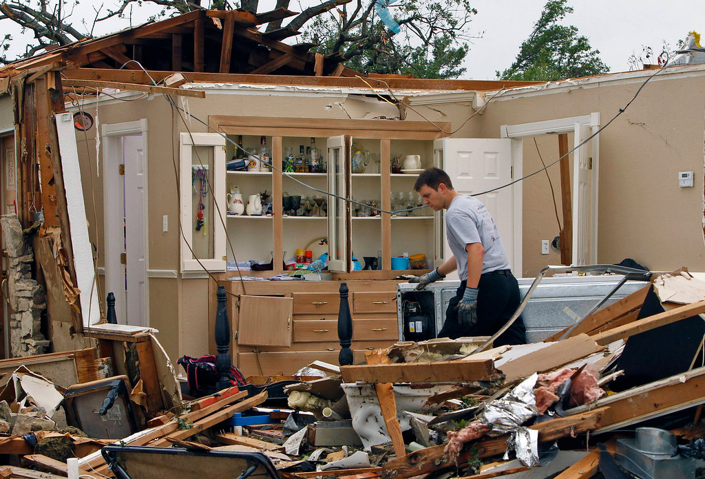. A rescue worker combs through debris May 16 after tornados swept through the town of Granbury, Texas late May 15, 2013. REUTERS/Richard Rodriguez