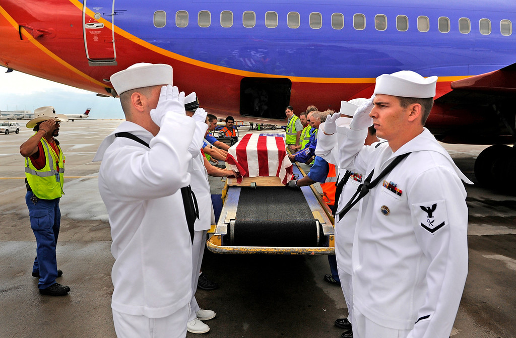 . The body of Jonathan Blunk, is loaded onto a plane at Denver International Airport, Friday, July 27, 2012, to fly to Reno, Nevada for his full military funeral. Blunk, a five-year U.S. Navy veteran, was killed during a July 20 shooting rampage at a movie theater in Aurora.