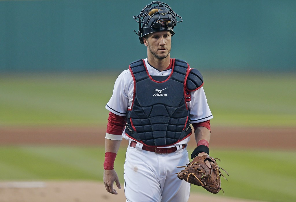 . Cleveland Indians\' Yan Gomes walks back to home plate before an interleague baseball game between the New York Mets and the Indians Friday, April 15, 2016, in Cleveland. (AP Photo/Tony Dejak)