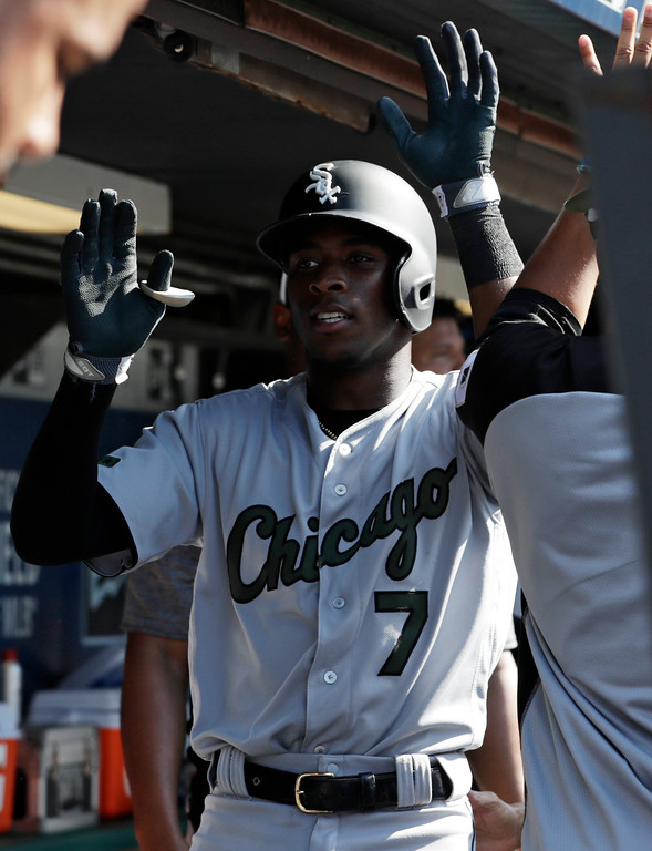. Chicago White Sox\'s Tim Anderson is congratulated by teammates after hitting a solo home run in the fourth inning of a baseball game against the Cleveland Indians, Monday, May 28, 2018, in Cleveland. (AP Photo/Tony Dejak)