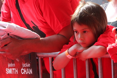 A fan waits for film stars Jaden Smith (son of Will Smith) and Jackie Chan to walk the red carpet for the Chicago screening of the Karate Kid at the AMC River East 21 in Chicago, IL,  USA on Wednesday 26, May 2010.