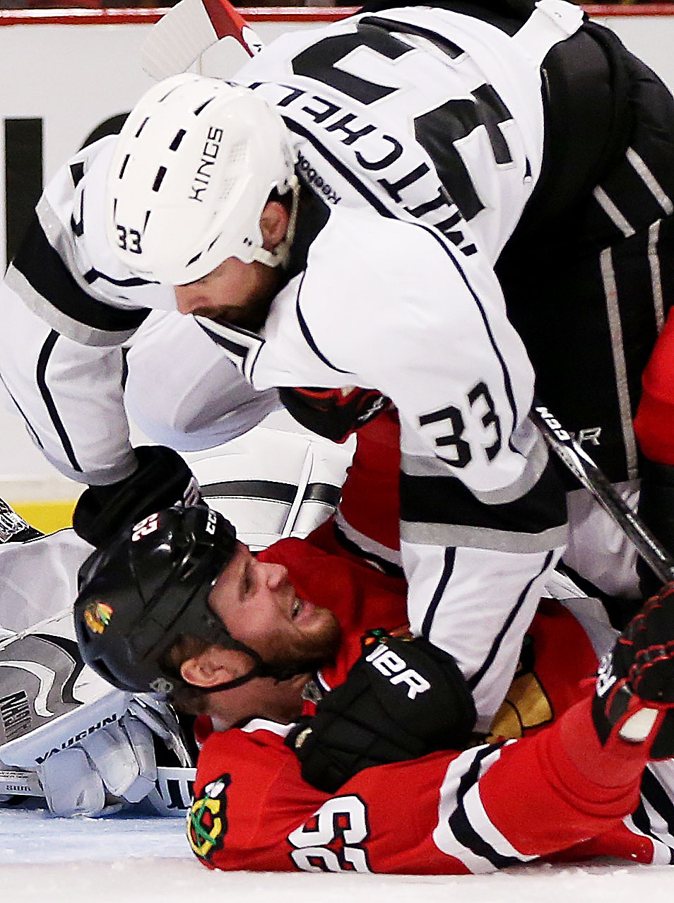 . Willie Mitchell #33 of the Los Angeles Kings fights with Bryan Bickell #29 of the Chicago Blackhawks in the third period of Game One of the Western Conference Final during the 2014 Stanley Cup Playoffs at United Center on May 18, 2014 in Chicago, Illinois.  (Photo by Jonathan Daniel/Getty Images)
