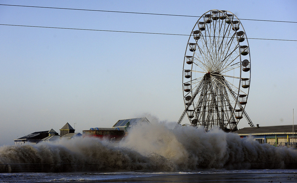 . Blackpool Main Promenade under flood water following high tide and a tidal surge as severe gale force winds hit the area, in Blackpool, England, Thursday Dec. 5, 2013.  Much of northwestern Europe braced for a storm that was expected to bring flooding to coastal areas.  (AP Photo/PA, John Giles)