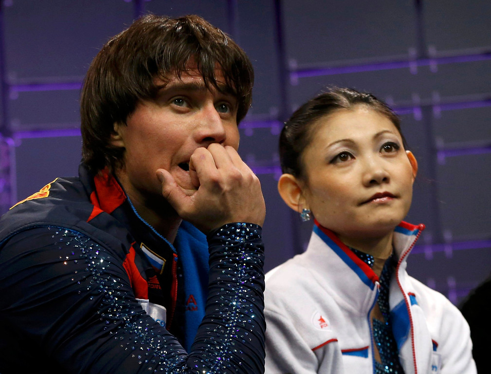 . Yuko Kavaguti (R) and Alexander Smirnov of Russia watch their score after they performed their free skating program at the ISU World Figure Skating Championships in London, March 15, 2013.   REUTERS/Mark Blinch