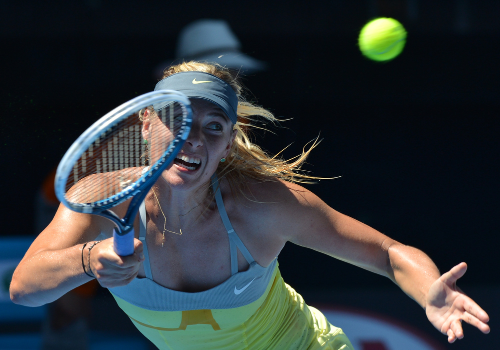 Description of . Russia's Maria Sharapova plays a return during her women's singles semi-final match against China's Li Na on the eleventh day of the Australian Open tennis tournament in Melbourne on January 24, 2013.   PAUL CROCK/AFP/Getty Images
