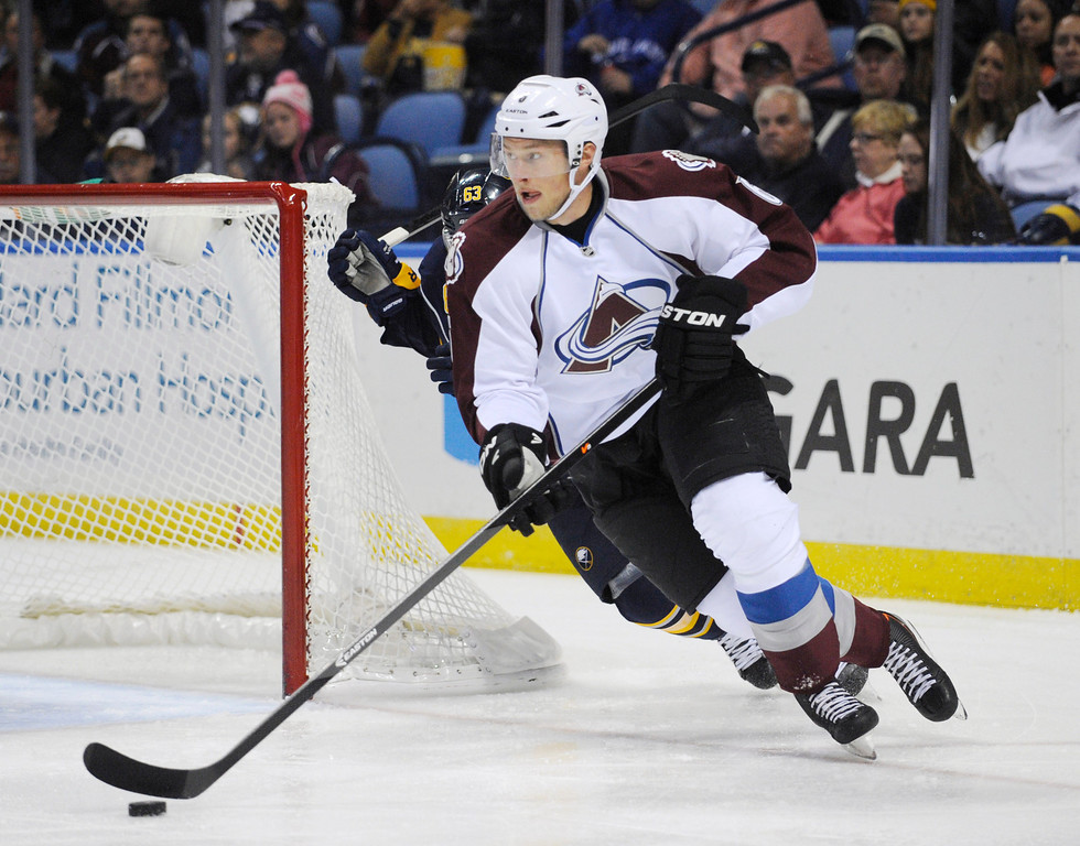 . Colorado Avalanche defenseman Jan Hejda (6), of the Czech Republic, carries the puck up ice as Buffalo Sabres center Tyler Ennis (63) defends during the first period of an NHL hockey game in Buffalo, N.Y., Saturday, Oct. 19, 2013. (AP Photo/Gary Wiepert)