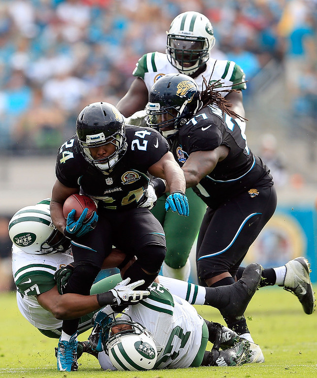 . JACKSONVILLE, FL - DECEMBER 09:   Montell Owens #24 of the Jacksonville Jaguars runs for yardage during the game against the New York Jets at EverBank Field on December 9, 2012 in Jacksonville, Florida.  (Photo by Sam Greenwood/Getty Images)
