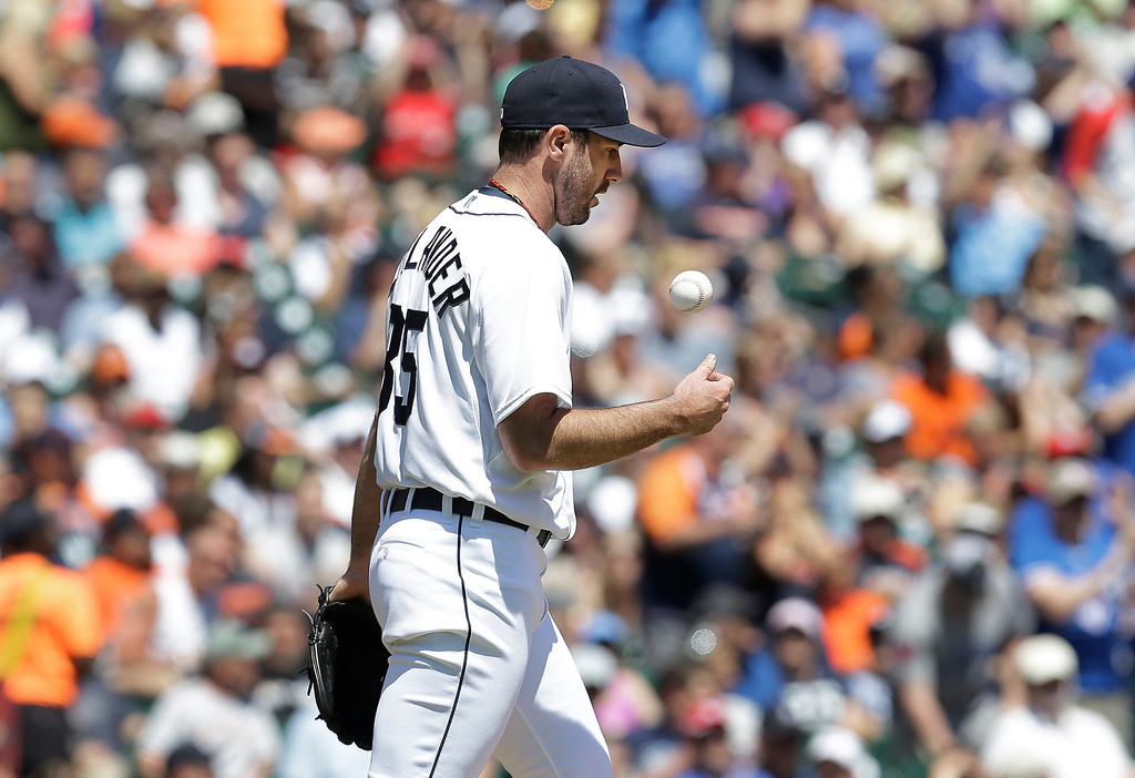 . Detroit Tigers pitcher Justin Verlander flips a ball after giving up a two-run home run to Toronto Blue Jays\' Juan Francisco in the sixth inning of a baseball game in Detroit, Thursday, June 5, 2014. (AP Photo/Paul Sancya)