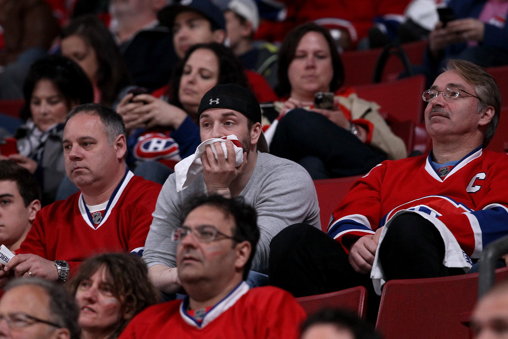 . MONTREAL, QC - MAY 17:  Montreal Canadiens fans look on late in the third period as the Canadiens take on the New York Rangers in Game One of the Eastern Conference Finals of the 2014 NHL Stanley Cup Playoffs at the Bell Centre on May 17, 2014 in Montreal, Canada.  (Photo by Bruce Bennett/Getty Images)
