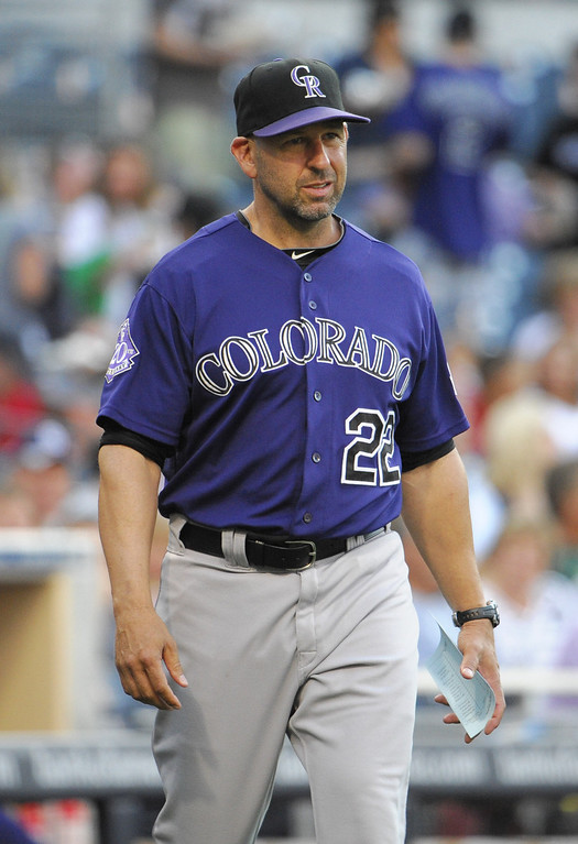 . Walt Weiss #22 manager of the Colorado Rockies walks onto the field before a baseball game against the San Diego Padres at Petco Park on July 8, 2013 in San Diego, California.  (Photo by Denis Poroy/Getty Images)