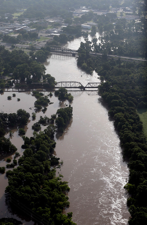 . In this aerial photo, the Colorado River flows out of it\'s banks Saturday, May 30, 2015, in Wharton, Texas. The Colorado River in Wharton and the Brazos and San Jacinto rivers near Houston are the main focus of concern as floodwaters moved from North and Central Texas downstream toward the Gulf of Mexico. (AP Photo/David J. Phillip)