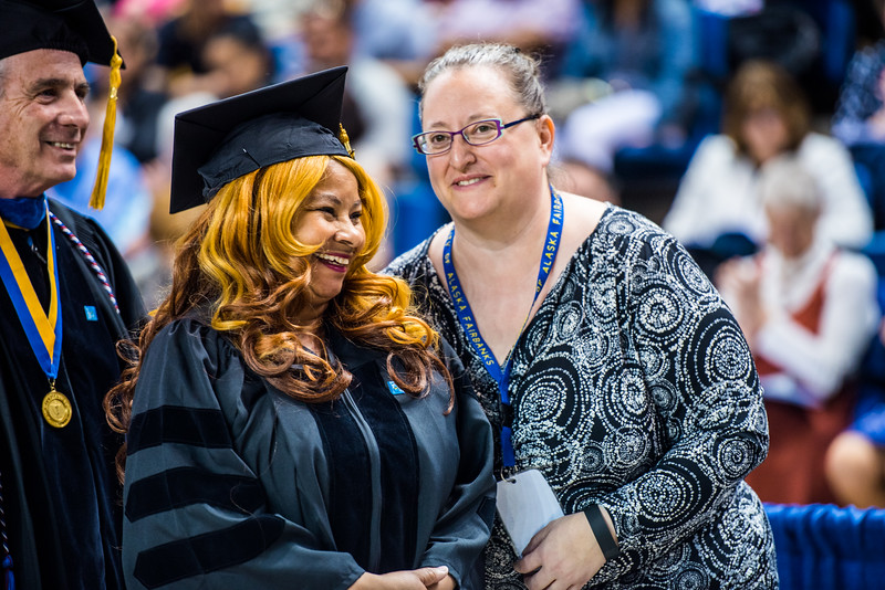 Doctorate recipient Linda Nicholas Figueroa smiles before posing for a photo during Commencement 2017.