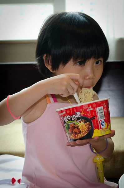 She likes noodles and I think they were expected to eat quickly at the orphanage.