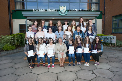 Sr Julie McGoldrick is pictured with some of the students who received their GCSE results. R1535016