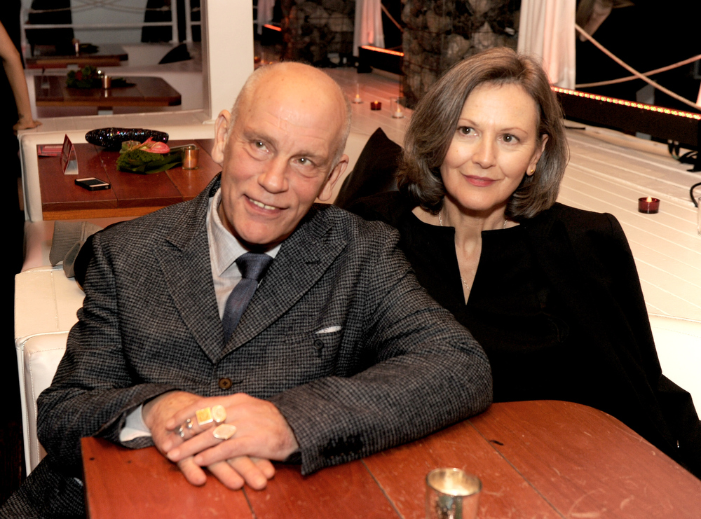 "Description of . Actor John Malkovich (L) and his wife Nicoletta Peyran pose at the after party for the premiere of Summit Entertainment\'s ""Warm Bodies\"" at The Colony on January 29, 2013 in Los Angeles, California.  (Photo by Kevin Winter/Getty Images)"