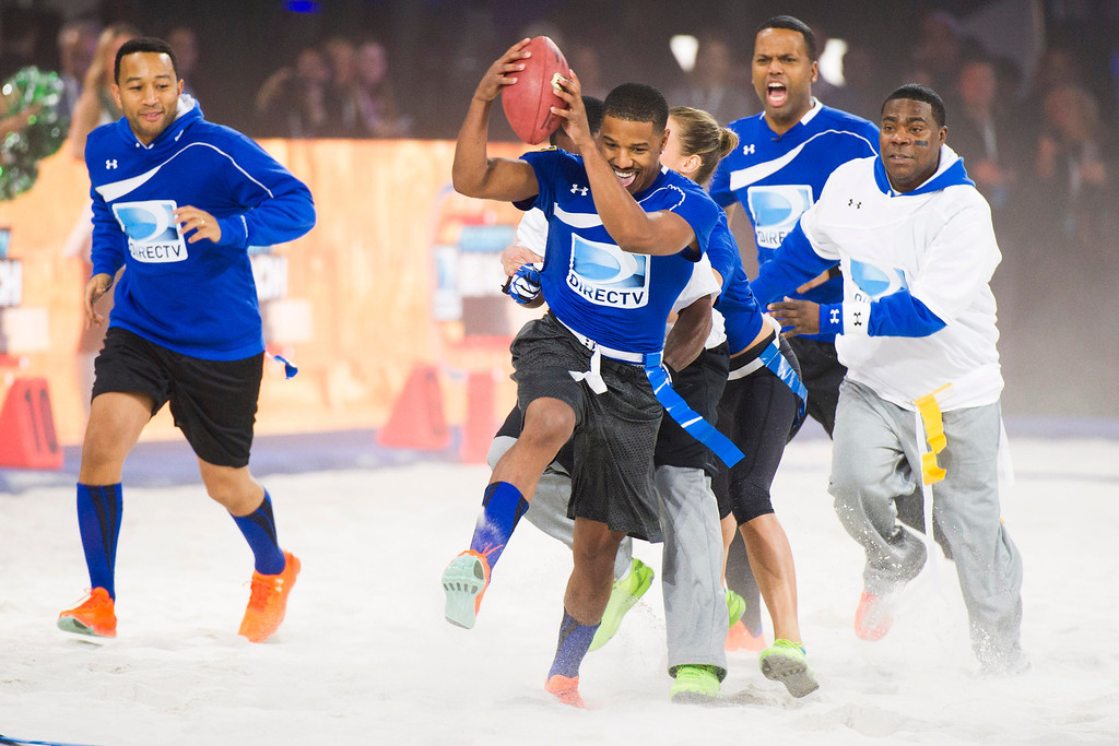 . John Legend, from left, Michael B. Jordan, AJ Calloway and Tracy Morgan competes in DIRECTV\'s 8th annual Celebrity Beach Bowl on Saturday, Feb. 1, 2014 in New York. (Photo by Charles Sykes/Invision/AP)
