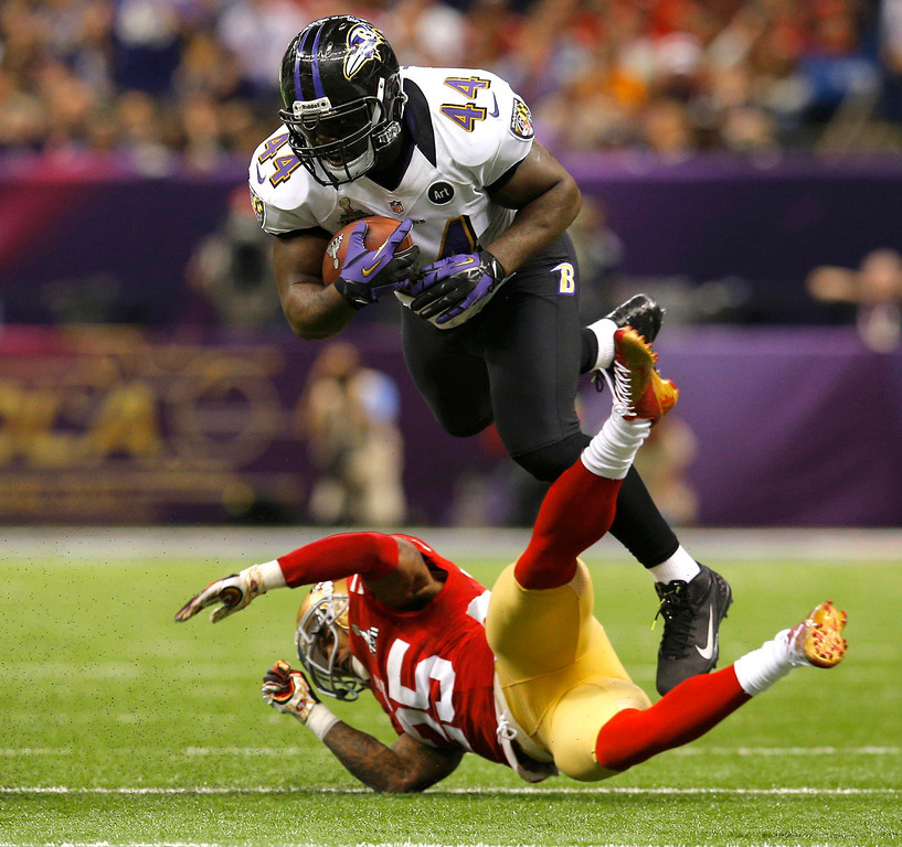 . Baltimore Ravens fullback Vonta Leach (44) collides with San Francisco 49ers cornerback Tarell Brown (25) during the second quarter of the NFL Super Bowl XLVII football game in New Orleans, Louisiana, February 3, 2013. REUTERS/Brian Snyder