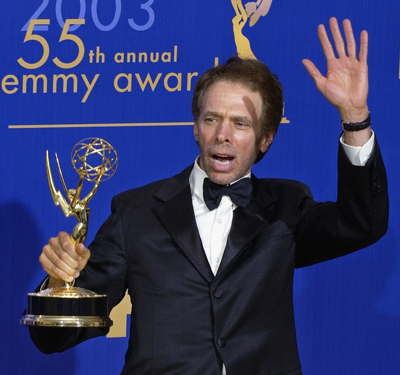 ". Executive producer Jerrry Bruckheimer displays the Emmy for outstanding reality/competition program won by ""Amaqzing Race\"" at the 55th annual Primetime Emmy Awards Sunday, Sept. 21, 2003, in Los Angeles. (AP Photos/Mark J. Terrill)"