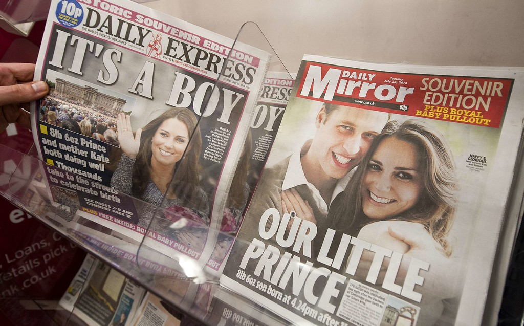 . Newspaper front pages report news of the birth of a new royal baby in London on July 23, 2013. International messages of congratulations poured in for the Duke and Duchess of Cambridge following the birth of the third in line to the throne, celebrated by gunfire salutes across London. AFP PHOTO / WILL OLIVER/AFP/Getty Images