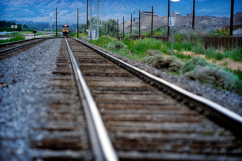 2011/8/3 – I went down to the railroad tracks by Utah Lake. I was set up to shoot a vanishing point image since the tracks run for miles in a straight line due south. I tried several different perspectives and was really focused in on getting a shot when I felt a funny vibration and turned around to see a train coming from the north. It wasn't the shot I was looking for but ended up being my best shot. Kind of fun when you get the unexpected. Had I been trying to get a train I would have waited for hours and never seen one.