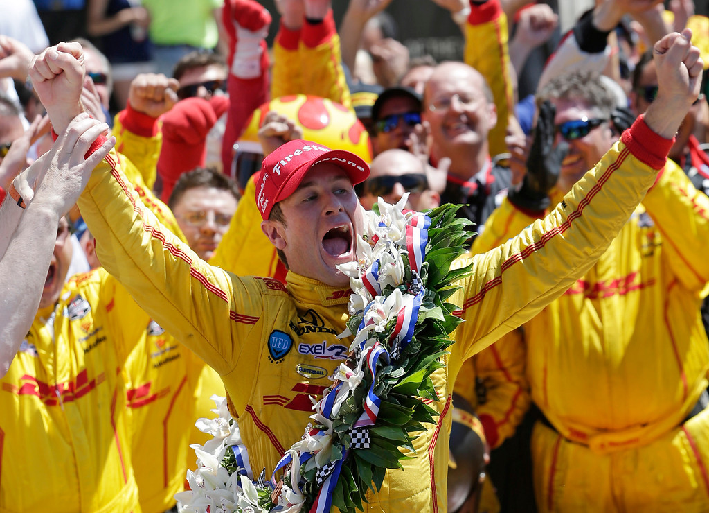 . Ryan Hunter-Reay celebrates winning the 98th running of the Indianapolis 500 IndyCar auto race at the Indianapolis Motor Speedway in Indianapolis, Sunday, May 25, 2014. (AP Photo/AJ Mast)