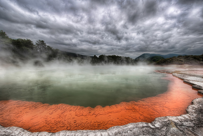 """The Artist's Palette in Rotorua Isn't this spot awesome?  I did not expect all this geothermal activity in New Zealand -- it was just as impressive as Yellowstone. This area of the north island is called Rotorua.  This, specifically is the Champagne Pool at the Artist's Palette at the Wai-o-tapu Thermal Wonderland.  The term """"Wonderland"""" always makes me think of a cheap attraction on the side of the road where you can buy rubber snakes after the kids have had a great time and the parents are bored out of their skulls.  But this Wonderland really was a Wonderland for all ages!  I made a few videos here as well... I need to get around to editing these things together for y'all!- Trey RatcliffClick here to read the rest of this post at the Stuck in Customs blog."""