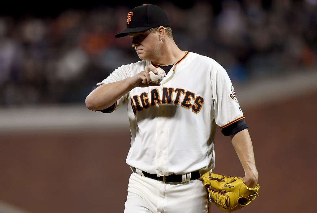 . SAN FRANCISCO, CA - MAY 05:  Matt Cain #18 of the San Francisco Giants stands on the mound and reacts while waiting on manager Bruce Bochy #18 to come take him out of the game against the Colorado Rockies in the top of the fifth inning at AT&T Park on May 5, 2016 in San Francisco, California.  (Photo by Thearon W. Henderson/Getty Images)