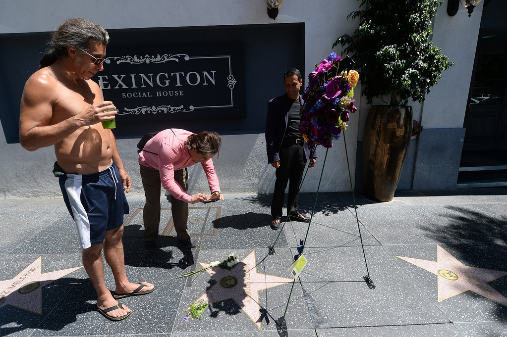 . Mickey Rooney�s star on the Hollywood Walk of Fame Monday, April 7, 2014. Flowers were placed on the star located at 1718 Vine Street to honor the actor who died Sunday at the age of 93. (Photo by Hans Gutknecht/Los Angeles Daily News)
