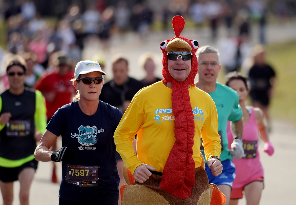 . Phil Regner runs in a turkey costume in the 40th Annual Turkey Trot in Washington Park in Denver, Colorado on November 28, 2013. Denver\'s largest Thanksgiving Day run benefits United Way and goes for 4 miles. (Photo by Hyoung Chang/The Denver Post)