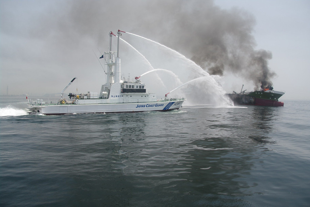 . This handout picture taken and released by Japan\'s Coast Guard on May 29, 2014 shows a Coast Guard boat (L) fighting a fire onboard the 998 ton oil tanker Shoko-Maru (R) off the coast of Hyogo prefecture, around 450 kilometers (280 miles) west of Tokyo. Japan\'s coastguard was rushing on May 29 to deal with an explosion and subsequent fire aboard a tanker off the country\'s coast, officials and the prime minister said.  AFP PHOTO / JAPAN COAST GUARD/AFP/Getty Images
