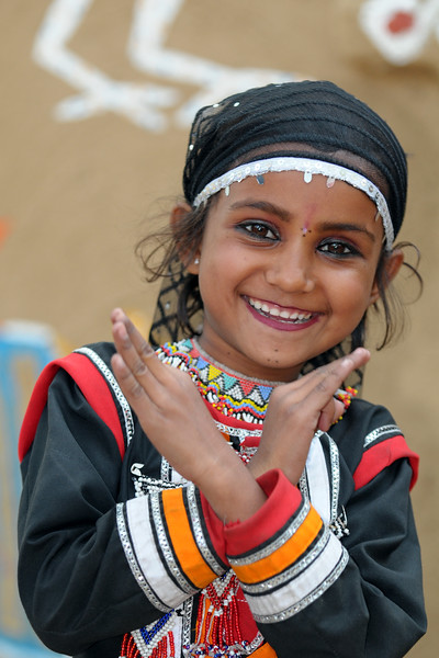 Child artist from Rajki-Puran Nath Sapera & Party, Jaipur photographed at the Suraj Kund Mela 2009 held in Haryana (outskirts of Delhi), North India. The Suraj Kund Mela is an annual fair held near Delhi. Folk dances, handicrafts and a lot of fun. Artists at the Surajkund Crafts Mela 2009, Haryana, North India. The Suraj Kund Mela is an annual fair held near Delhi. Folk dances, musical performances, handicrafts on display & sale and and a lot of fun & excitement for everyone.