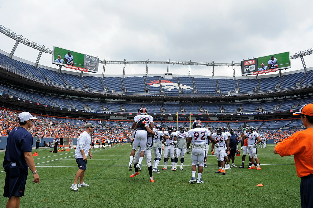 . The Denver Broncos defense runs through drills on day four of the Denver Broncos 2014 training camp July 27, 2014 atSports Authority Field at Mile High.  (Photo by John Leyba/The Denver Post)