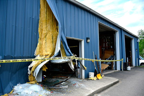 7/31/2019 Mike Orazzi | Staff Damage to the Southington Glass Company after a woman crashes her vehicle into the building on Wednesday morning. No injuries were reported.