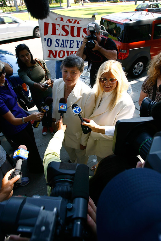 . BEVERLY HILLS, CA - JUNE 16:  Guests, onlookers, and protesters surround lesbian couple Robin Tyler and Diane Olson (R) as they talk to the media after they are joined in the first legally recognized same-sex marriage in Los Angeles County, outside the Beverly Hills courthouse on June 16, 2008 in Beverly Hills, California. The two were plaintiffs in one of the lawsuits that led to the overturning of California\'s gay marriage ban. Gay and Lesbian marriages became legal in California at 5:01 p.m. The California Supreme Court refused to stay its decision legalizing same-sex marriage despite calls by conservative and religious opponents, before an initiative to amend the state constitution to ban gay marriage goes to ballot in November. A study released by University of California Los Angeles (UCLA) this month projects that nearly half of the state\'s 102,600 same-sex couples will marry in the next three years and, along with same-sex couples from other states, will spend more than $683 million on weddings, honeymoons and other marriage-related activities.  (Photo by David McNew/Getty Images)