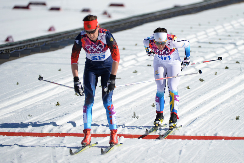 . Yulia Tchekaleva of Russia (L) and Charlotte Kalla of Sweden cross the finish line the Women\'s 10 km Classic during day six of the Sochi 2014 Winter Olympics at Laura Cross-country Ski & Biathlon Center on February 13, 2014 in Sochi, Russia.  (Photo by Harry How/Getty Images)