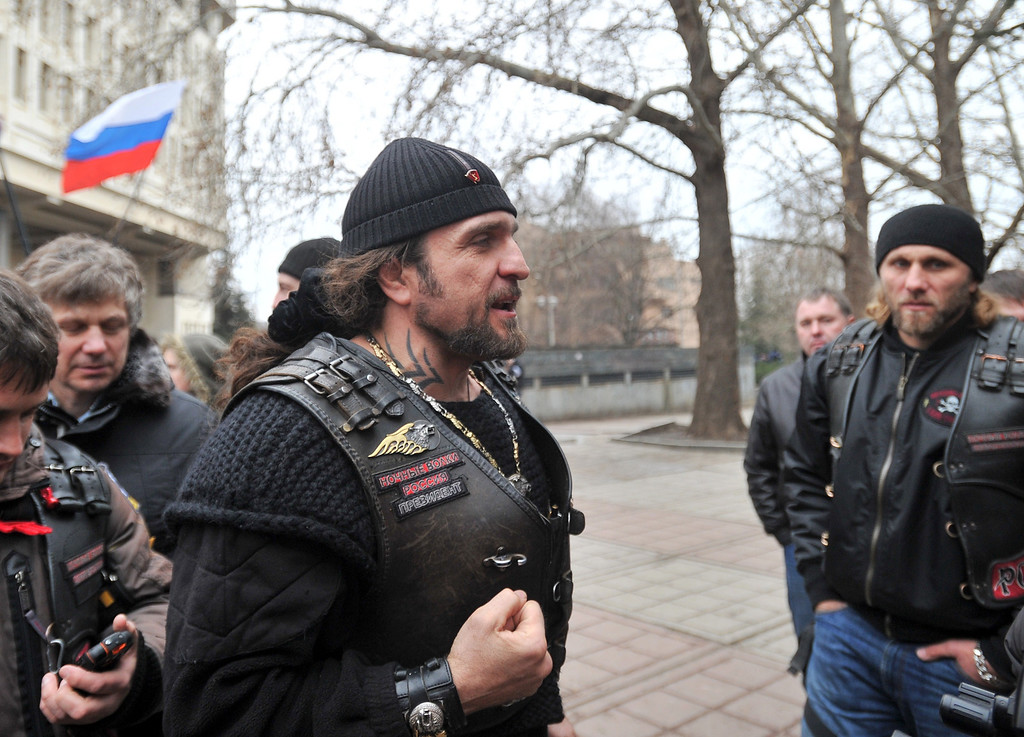 ". Alexander Zaldostanov (C), nicknamed ""the Surgeon\"", leader of a group of Russian bikers called the Night Wolves, attends a rally of pro-Russian activists waving the Russian flag, in front of the local parliament building on February 28, 2014 in Simferopol, Crimea, Ukraine\'s strategic peninsula. Pro-Russian activists flexed their muscles in in Crimea on Friday, swarming government buildings after Kalashnikov-toting men in fatigues descended on two key airports, as tensions mounted over the strategic Ukrainian peninsula. Hundreds of pro-Moscow protesters in Crimea\'s capital Simferopol massed outside the regional parliament, seized on February 27, 2014 by separatist commandos, as 50 others formed a barricade outside the Ukrainian presidency\'s local office, blocking its newly designated director from going inside. AFP PHOTO/ GENYA  SAVILOV/AFP/Getty Images"