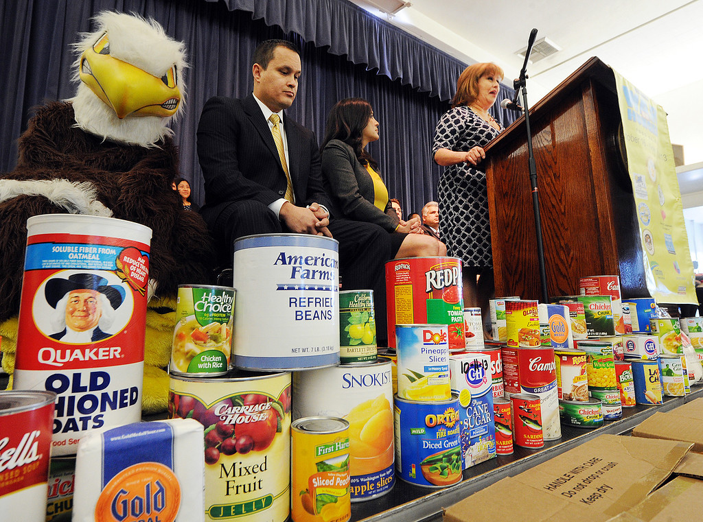 """. Gerri Guzman, V.P. Board of Education at Montebello Unified School District speaking about \""""War On Hunger\"""" food drive.The Montebello Unified School District and its partners bringing the community together to assist local families in need through its 5th Annual \""""War on Hunger\"""", Food Drive.  the District\'s Kick-Off Event was held at Montebello Intermediate School Wednesday, October 16, 21013. (Photos by Walt Mancini/Pasadena Star-News)"""