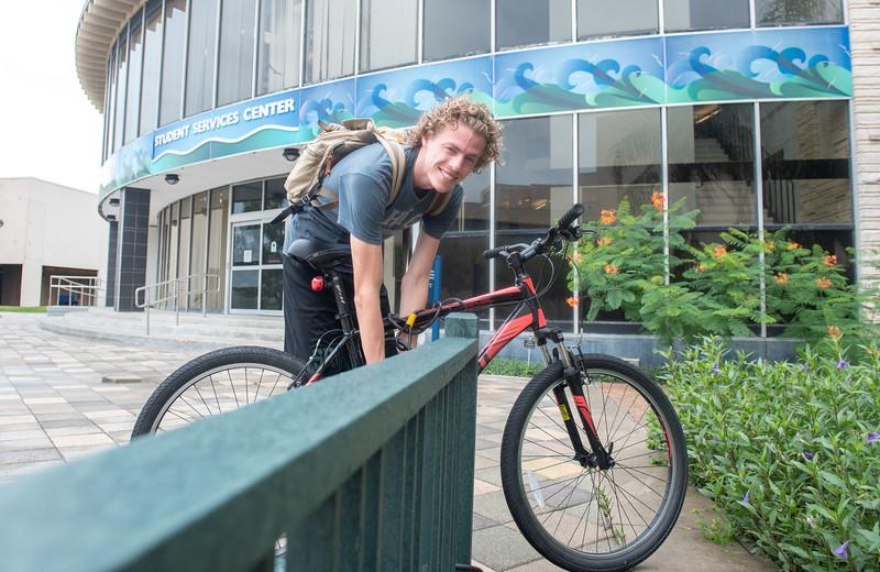 Alex Berner retrieves his bike from one of the many bike racks located around campus.
