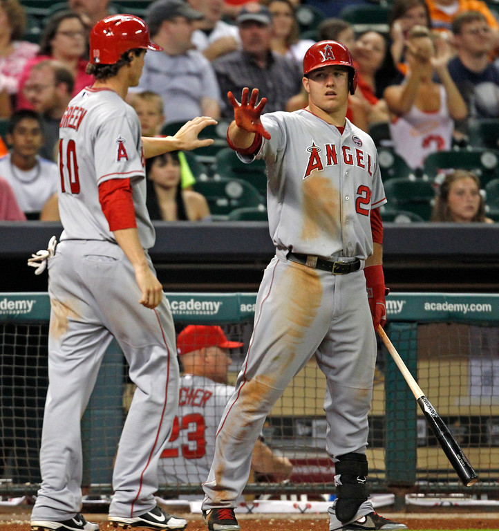 . Los Angeles Angels\' Grant Green, left, is congratulated by Mike Trout after scoring in the ninth inning of a baseball game against the Houston Astros on Saturday, Sept. 14, 2013, in Houston. The ANgels won 6-2. (AP Photo/Eric Christian Smith)