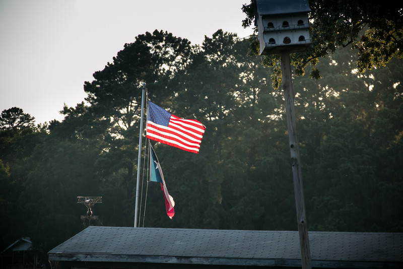 rising sun catches flag
