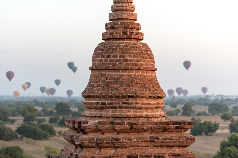 Hot-air Balloons in flight over temples of Bagan as seen from Pyathada Paya, Burma - Myanmar