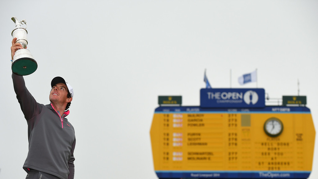 . Rory McIlroy of Northern Ireland holds the Claret Jug aloft after his two-stroke victory at The 143rd Open Championship at Royal Liverpool on July 20, 2014 in Hoylake, England.  (Photo by Stuart Franklin/Getty Images)