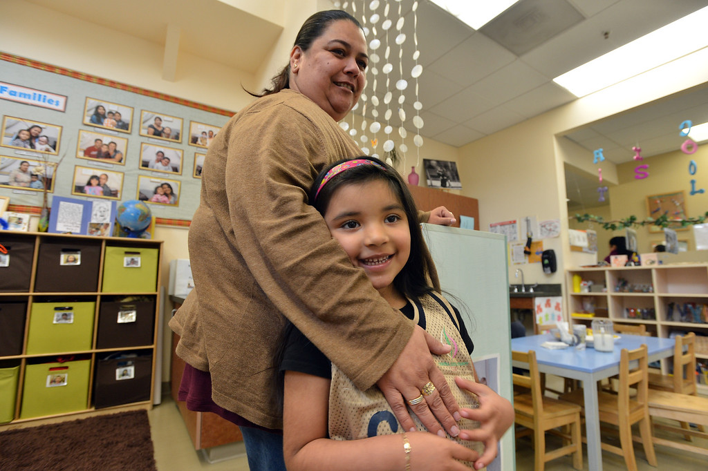 . Micaela Ramos spends a few minutes with daughter Arelee Rodriguez, 5, as she drops her off at the George Miller III Children\'s Center in Richmond, Calif. on Wednesday, Feb. 27, 2013. Funding for the daycare center could be jeopardized by automatic spending cuts by the federal government. (Kristopher Skinner/Staff)