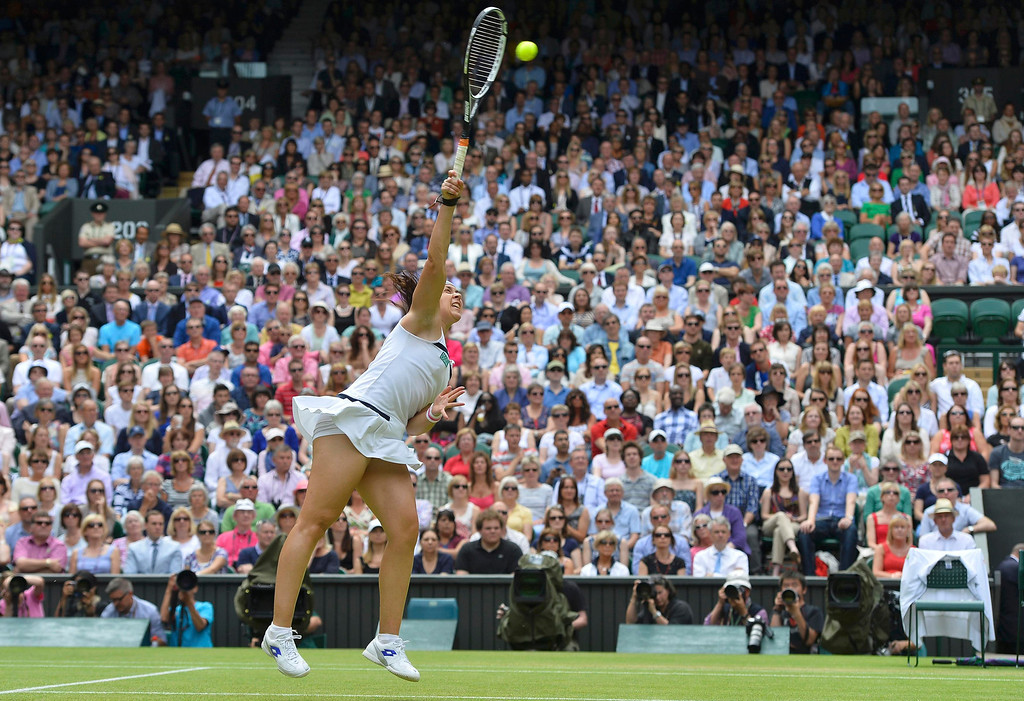 . Marion Bartoli of France serves to Kirsten Flipkens of Belgium during their women\'s semi-final tennis match at the Wimbledon Tennis Championships, in London July 4, 2013. REUTERS/Toby Melville