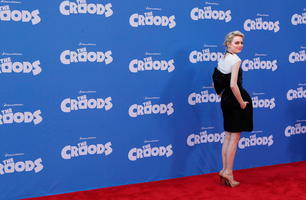 """. Cast member Emma Stone arrives for the premiere of the film \""""The Croods\"""" in New York, March 10, 2013.  REUTERS/Carlo Allegri"""