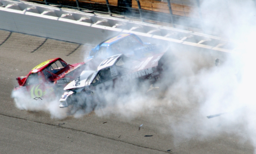 . NASCAR Craftsman trucks of Steve Park, right, Mike Bliss, left, and Eric Norris, top center, crash during running of the EasyCare Vehicle Service Contracts 200 at Atlanta Motor Speedway in Hampton, Ga., Saturday, Oct. 29, 2005. (AP Photo/Joe Sebo)