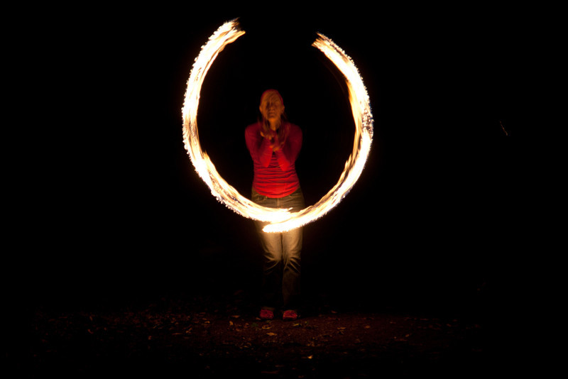 Julia amazes folks at the bonfire with a Fire Poi performance.  Do NOT try this at home.