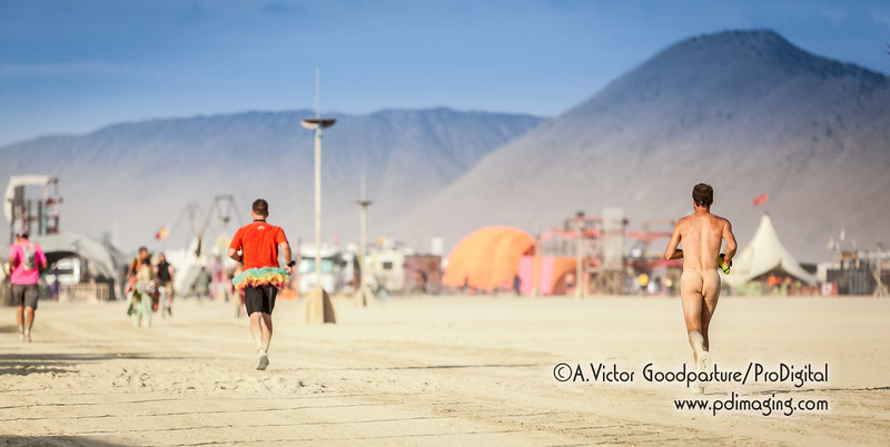 """Another naked runner. For the uninitiated, there is nudity in Burning Man and both men and women do select various stages of dress. After a few days, the shock value wears off and you """"almost"""" don't notice it. (The exception was the 80-year-old couple that wore nothing but tennis shoes and smiles.)"""